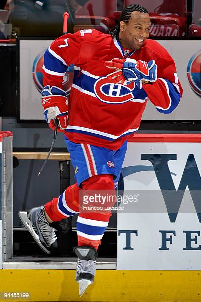 Georges Laraque of the Montreal Canadiens happily jumps on the ice for warm up before the NHL game against the Buffalo Sabres on December 14 2009 at...