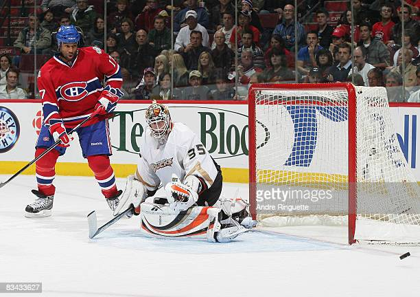 Georges Laraque of the Montreal Canadiens looks on as a rebound goes wide after a save by JeanSebastien Giguere of the Anaheim Ducks at the Bell...