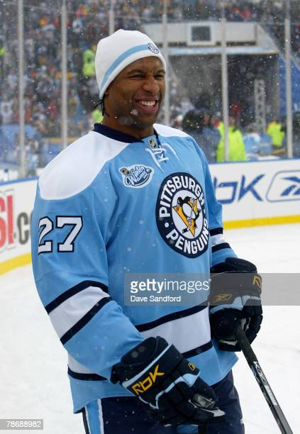 Georges Laraque of the Pittsburgh Penguins smiles during warm ups prior to taking on the Buffalo Sabres in the NHL Winter Classic on January 1 2008...