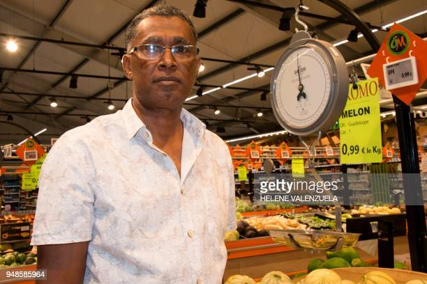Georges Malpole in charge at the 'O Marche' supermarket poses in SaintFrancois on the French overseas territory of Guadeloupe on April 11 2018