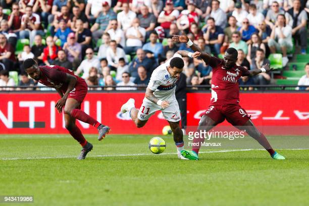 Georges Mandjeck of Metz and Memphis Depay of Lyon and Fallou Diagne of Metz during the Ligue 1 match between Metz and Olympique Lyonnais at on April...
