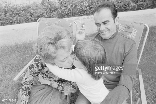 Georges Marchais Secretary General of the French Communist Party watches as his wife Liliane receives a kiss from their daughter in the backyard of...