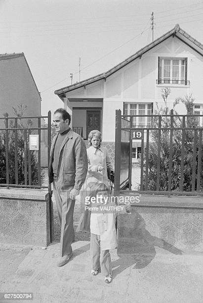 Georges Marchais Secretary General of the French Communist Party leaves his house in ChampignysurMarne France with his daughter and wife Liliane