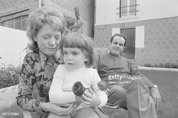 Georges Marchais Secretary General of the French Communist Party sits in the backyard with his wife Liliane and daughter at his family's home in...