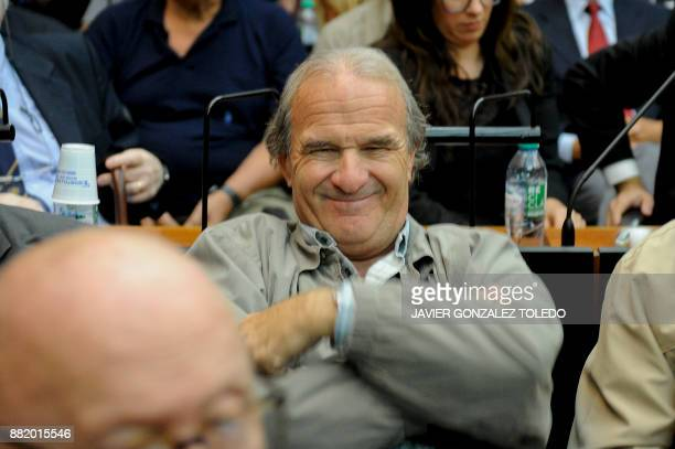 Georges Mario Daniel Arru pilot during Argentina's military dictatorship and already convicted for earlier charges smiles during his sentencing...
