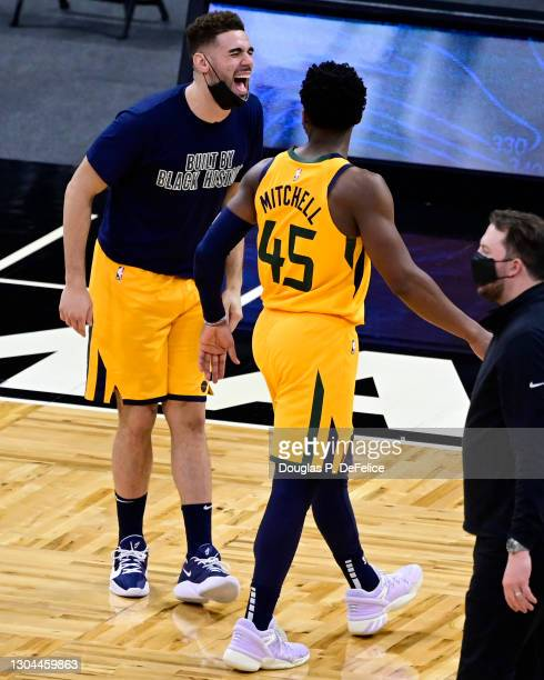 Georges Niang and Donovan Mitchell of the Utah Jazz interact during the fourth quarter against the Orlando Magic at Amway Center on February 27, 2021...