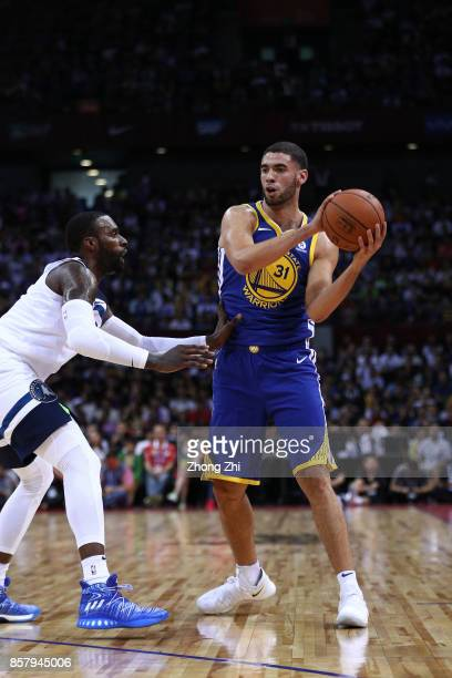Georges Niang of the Golden State Warriors in action against Shabazz Muhammad of the Minnesota Timberwolves during the game between the Minnesota...