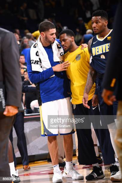 Georges Niang of the Golden State Warriors talks with Monte Morris of the Denver Nuggets after the game during a preseason game on September 30 2017...