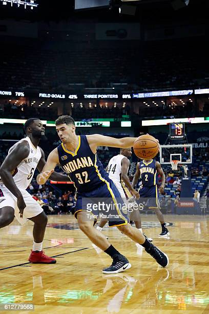 Georges Niang of the Indiana Pacers drives to the basket against the New Orleans Pelicans during a preseason game on October 4 2016 at the Smoothie...