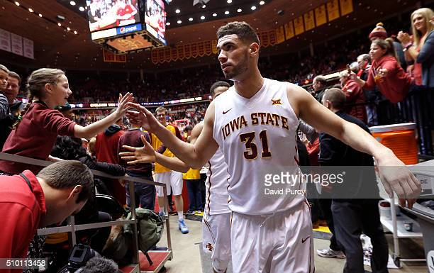Georges Niang of the Iowa State Cyclones celebrates with fans after the Iowa State Cyclones won 8575 over the Texas Longhorns at Hilton Coliseum on...