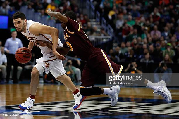 Georges Niang of the Iowa State Cyclones drives the ball around Rickey McGill of the Iona Gaels during the first round of the 2016 NCAA Men's...