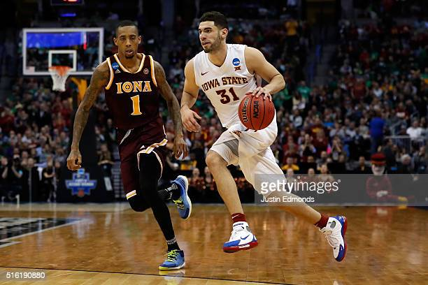 Georges Niang of the Iowa State Cyclones drives the ball around Isaiah Williams of the Iona Gaels during the first round of the 2016 NCAA Men's...