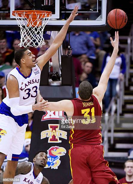 Georges Niang of the Iowa State Cyclones goes up against Landen Lucas of the Kansas Jayhawks in the second half during the championship game of the...
