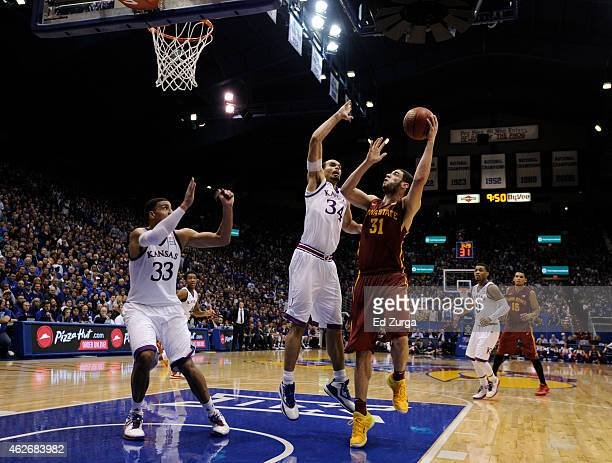 Georges Niang of the Iowa State Cyclones lays the ball up against Landen Lucas and Perry Ellis of the Kansas Jayhawks in the second half at Allen...