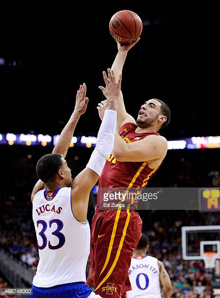 Georges Niang of the Iowa State Cyclones shoots over Landen Lucas of the Kansas Jayhawks in the first half during the championship game of the Big 12...