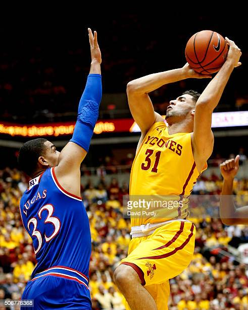 Georges Niang of the Iowa State Cyclones takes a shot as Landen Lucas of the Kansas Jayhawks blocks in the first half of play at Hilton Coliseum on...