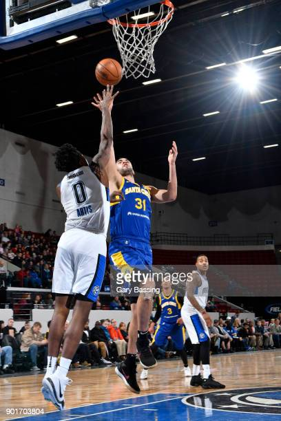 Georges Niang of the Santa Cruz Warriors shoots against Jamel Artis of the Lakeland Magic during the game on January 5 2018 at RP Funding Center in...