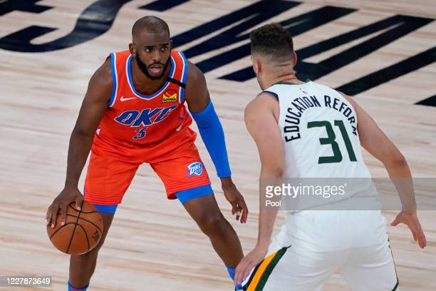 Georges Niang of the Utah Jazz guards Chris Paul of the Oklahoma City Thunder during the first half of an NBA basketball game on August 1, 2020 in...