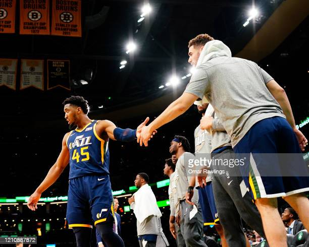 Georges Niang of the Utah Jazz reacts with Donovan Mitchell of the Utah Jazz from the bench during the fourth quarter of the game at TD Garden on...
