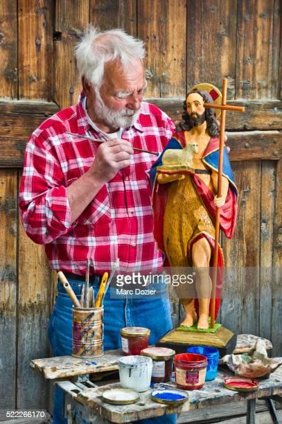 Georges Personnaz painting a saint
