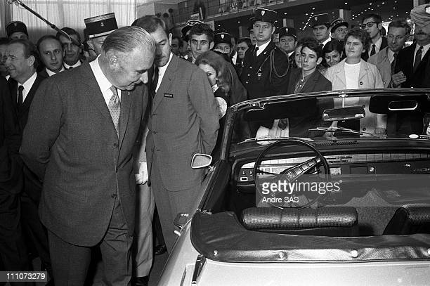 Georges Pompidou with Peugeot 304 in the car showroom in Paris France in 1970