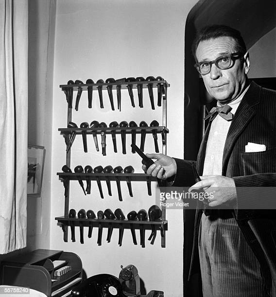 Georges Simenon , Belgian writer and his collection of pipes. Echandens , december 9, 1963.