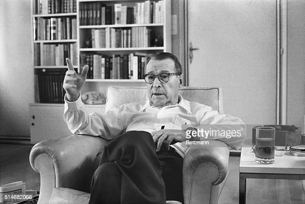 Georges Simenon speaks during an interview on his 75th birthday. The prominent mystery novelist comments that he hates fiction, but loves puppeteer...