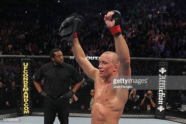 Georges StPierre celebrates after he won his fight by unanimous decision against Josh Koscheck during their Welterweight Title bout during UFC 124 at...