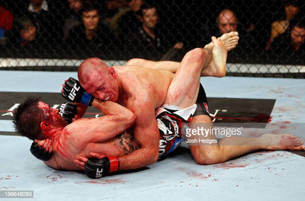 Georges StPierre grapples against Carlos Condit in their welterweight title bout during UFC 154 on November 17 2012 at the Bell Centre in Montreal...
