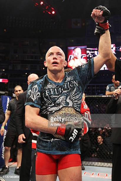 Georges StPierre is celebrates defeating Jake Shields by unanimous decision after five rounds of their Welterweight Championship bout at UFC 129 in...