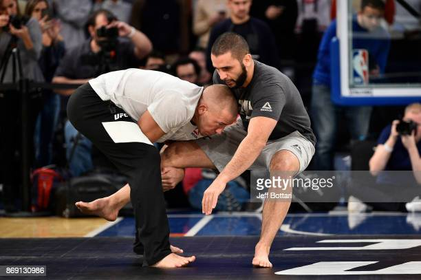 Georges St-Pierre of Canada and coach Firas Zahabi hold an open workout session for fans and media inside Madison Square Garden on November 1, 2017...