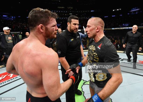 Georges StPierre of Canada and Michael Bisping of England shake hands after their UFC middleweight championship bout during the UFC 217 event at...