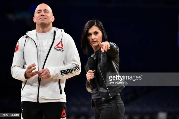 Georges St-Pierre of Canada and UFC host Megan Olivi interact with fans and media inside Madison Square Garden on November 1, 2017 in New York City.