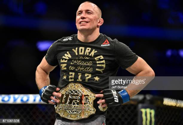 Georges StPierre of Canada celebrates after defeating Michael Bisping of England in their UFC middleweight championship bout during the UFC 217 event...