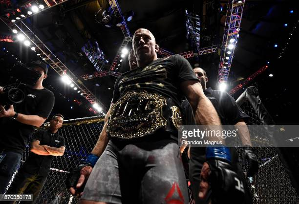 Georges StPierre of Canada celebrates his submission victory over Michael Bisping of England in their UFC middleweight championship bout during the...