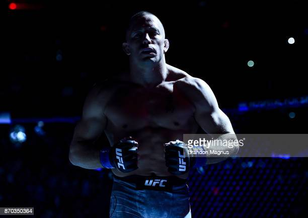 Georges StPierre of Canada enters the octagon before facing Michael Bisping of England in their UFC middleweight championship bout during the UFC 217...