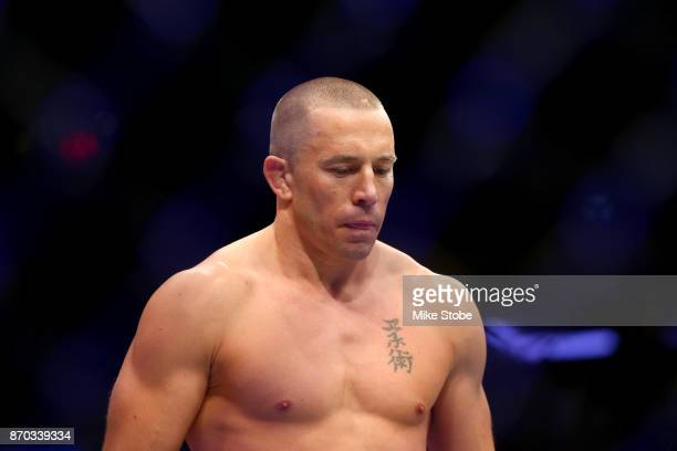 Georges StPierre of Canada enters the octagon for his UFC middleweight championship bout against Michael Bisping of England during the UFC 217 event...