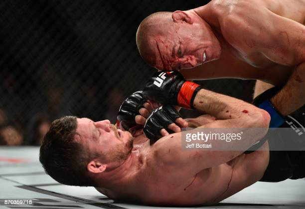 Georges StPierre of Canada fights Michael Bisping of England in their UFC middleweight championship bout during the UFC 217 event at Madison Square...