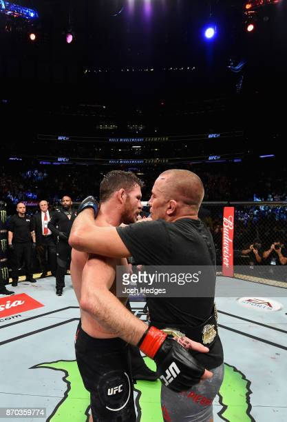 Georges StPierre of Canada hugs Michael Bisping of England in their UFC middleweight championship bout during the UFC 217 event at Madison Square...