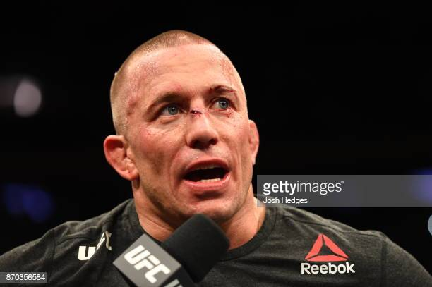 Georges StPierre of Canada is interviewed after defeating Michael Bisping of England in their UFC middleweight championship bout during the UFC 217...