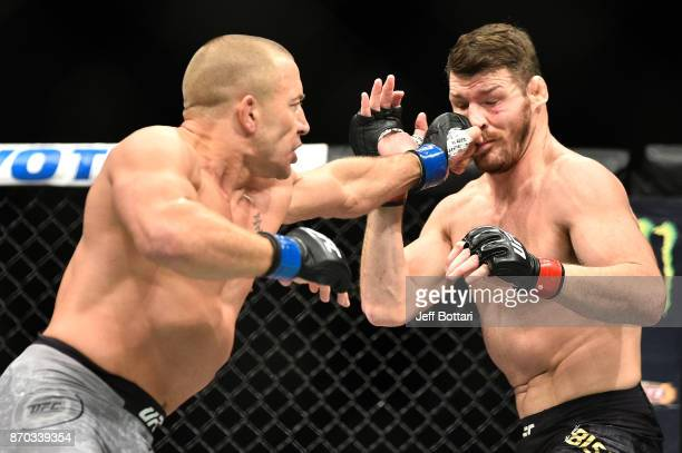 Georges StPierre of Canada lands a punch agains Michael Bisping of England in their UFC middleweight championship bout during the UFC 217 event at...