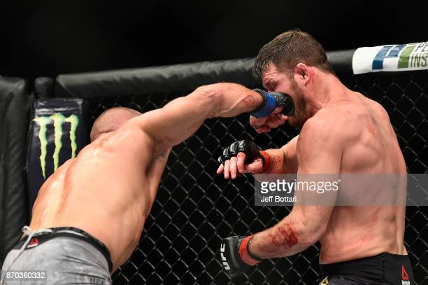 Georges StPierre of Canada lands a punch against Michael Bisping of England in their UFC middleweight championship bout during the UFC 217 event at...