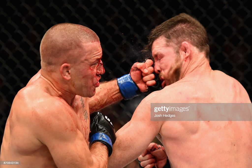 Georges St-Pierre of Canada lands a punch to take down Michael Bisping of England in their UFC middleweight championship bout during the UFC 217 event at Madison Square Garden on November 4, 2017 in New York City.