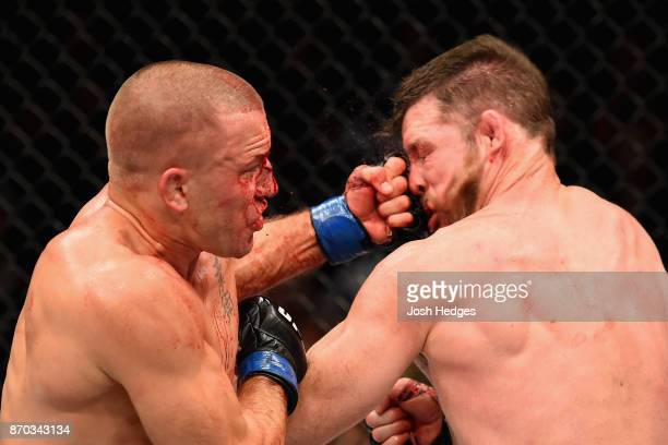 Georges StPierre of Canada lands a punch to take down Michael Bisping of England in their UFC middleweight championship bout during the UFC 217 event...