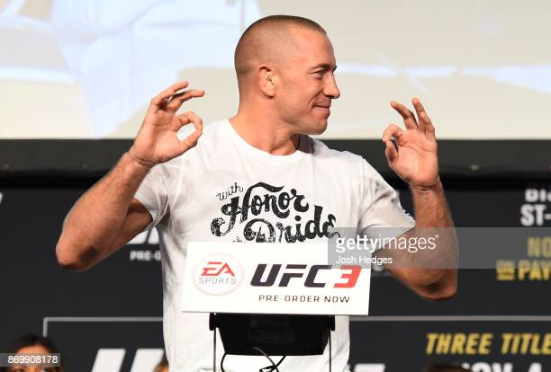 Georges StPierre of Canada poses on the scale during the UFC 217 weighin inside Madison Square Garden on November 3 2017 in New York City