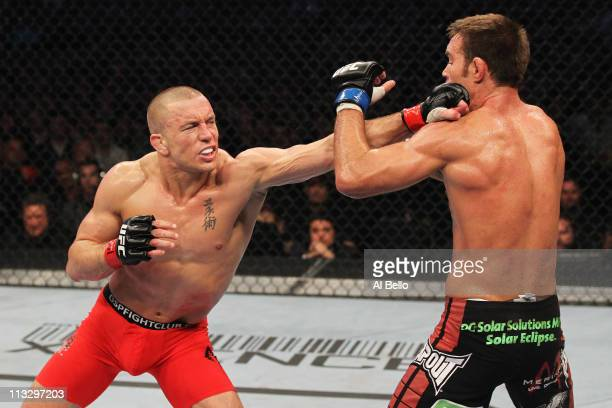 Georges StPierre punches Jake Shields during their Welterweight Championship bout at UFC 129 in the Rogers Centre on April 30 2011 in Toronto Ontario