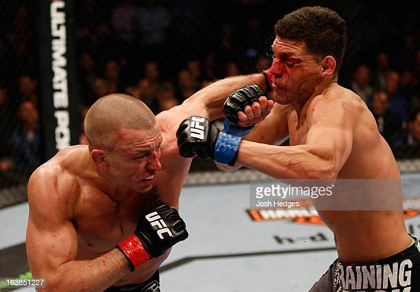 Georges StPierre punches Nick Diaz in their welterweight championship bout during the UFC 158 event at Bell Centre on March 16 2013 in Montreal...