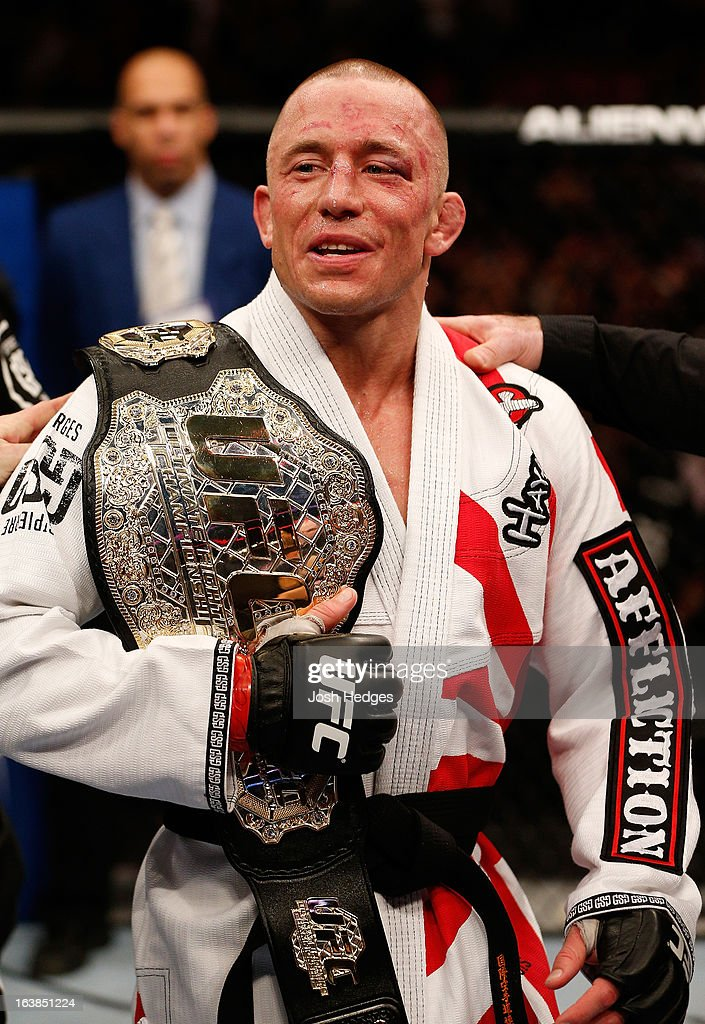Georges St-Pierre reacts after his victory over Nick Diaz in their welterweight championship bout during the UFC 158 event at Bell Centre on March 16, 2013 in Montreal, Quebec, Canada.