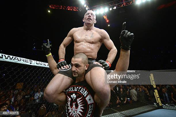 Georges StPierre reacts to his victory over Johny Hendricks in their UFC welterweight championship bout during the UFC 167 event inside the MGM Grand...