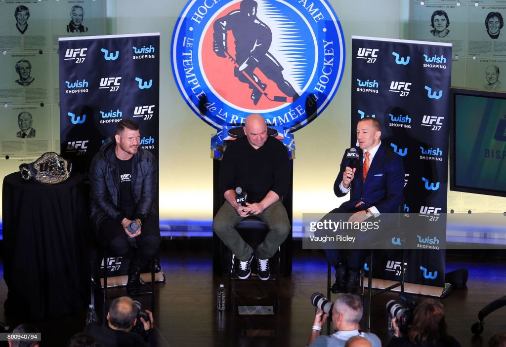 Georges St-Pierre speaks to the media during the UFC 217 press conference with Michael Bisping and Dana White at the Hockey Hall of Fame on October 13, 2017 in Toronto, Canada.